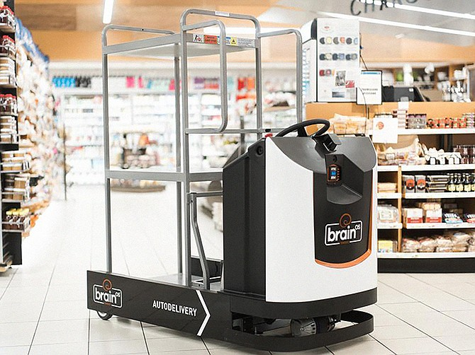 Photo courtesy of Brain Corp. Brain Corp's software, along with sensor and camera systems, power self-driving robotic floor scrubbers used by Walmart and other large stores.