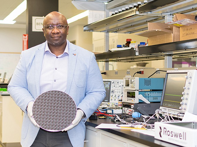 Roswell Microchip: Paul Mola holds one of Roswell Biotech's microchips used for DNA sequencing.