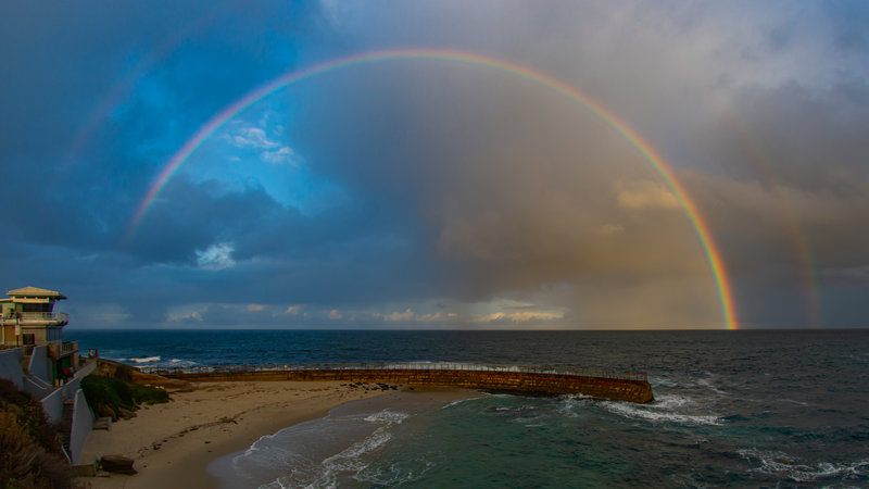 A rainbow appeared over the Children's Pool in La Jolla after a recent storm. PHOTO BY JIM GRANT