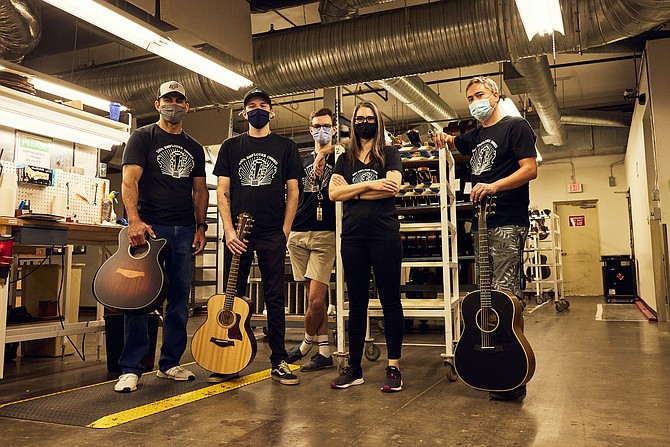 Marking Taylor Guitars' change to employee ownership and wearing shirts for the occasion are factory employees Sammy Michel (left), Dylan Razwick, Cameron Foley, Liz Barth and Ethan Lack. Photo courtesy of Taylor Guitars.