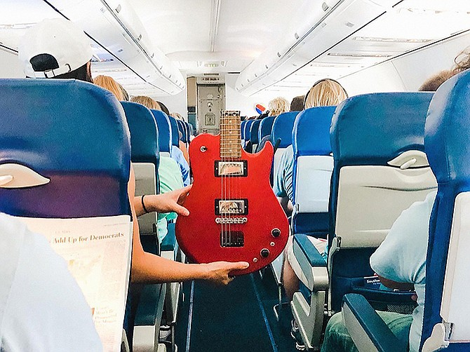 Photo courtesy of Ciari Guitars. Jonathan Spangler designed full-sized, portable guitars that can be carried on an airplane. A switch lowers the tension in the guitar's strings, allowing it to fold at the neck.
