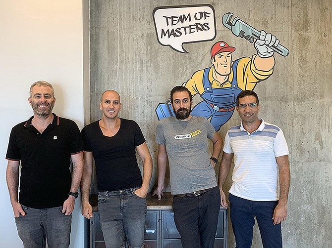 Photo courtesy of Workiz. From right to left, Workiz CEO Adi Azaria and co-founder Ian Kadosh, and team members.